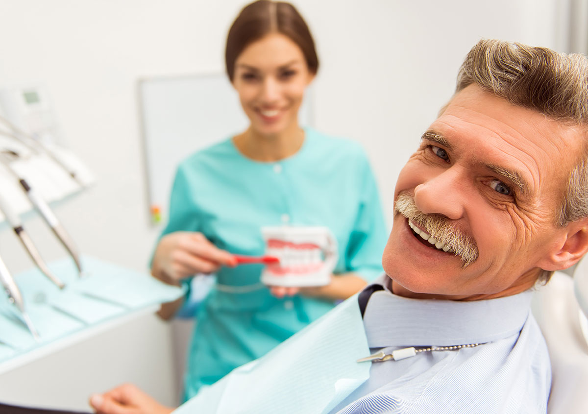 Senior man and dentist are smiling together