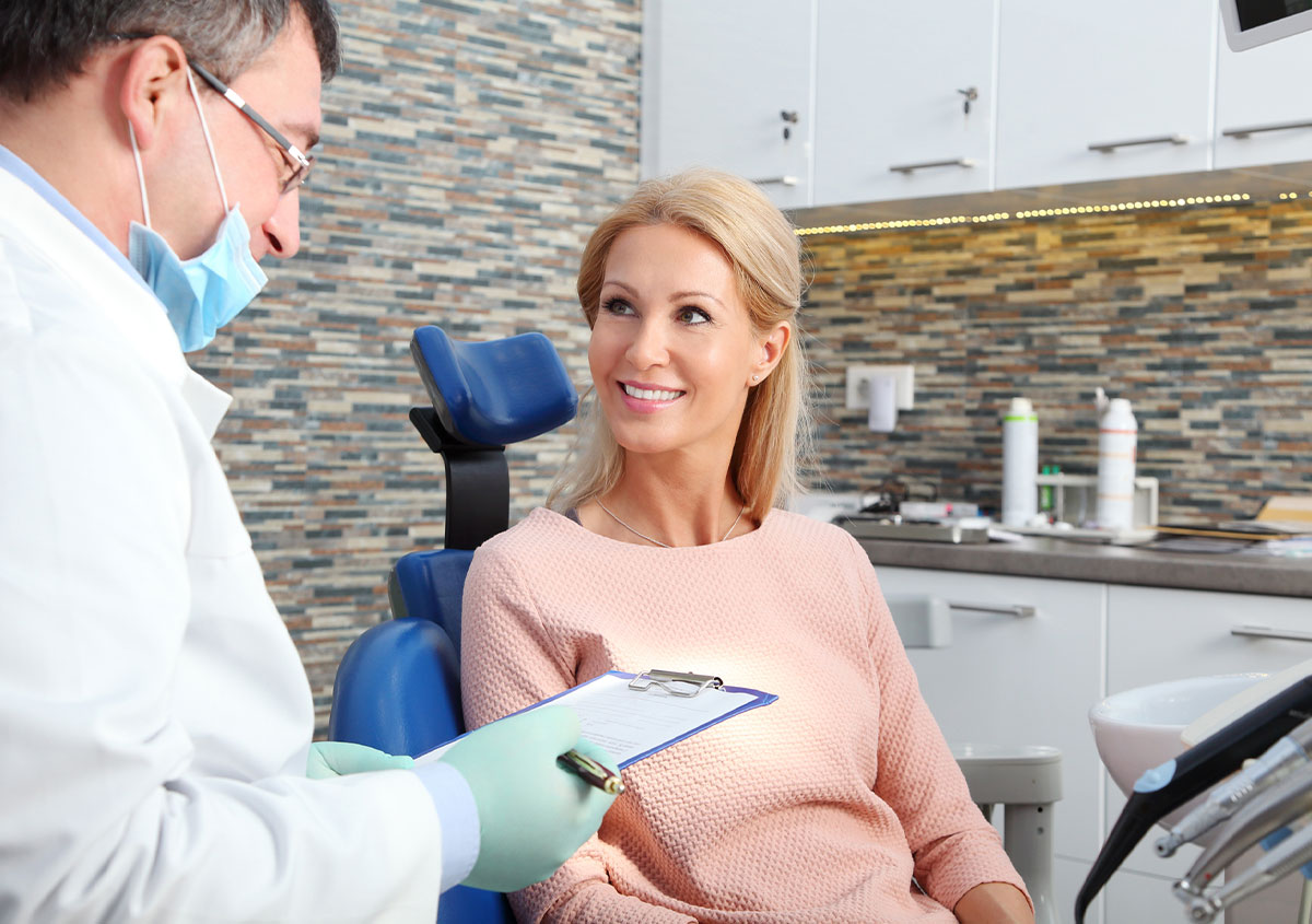 A dentist is getting information about his patient
