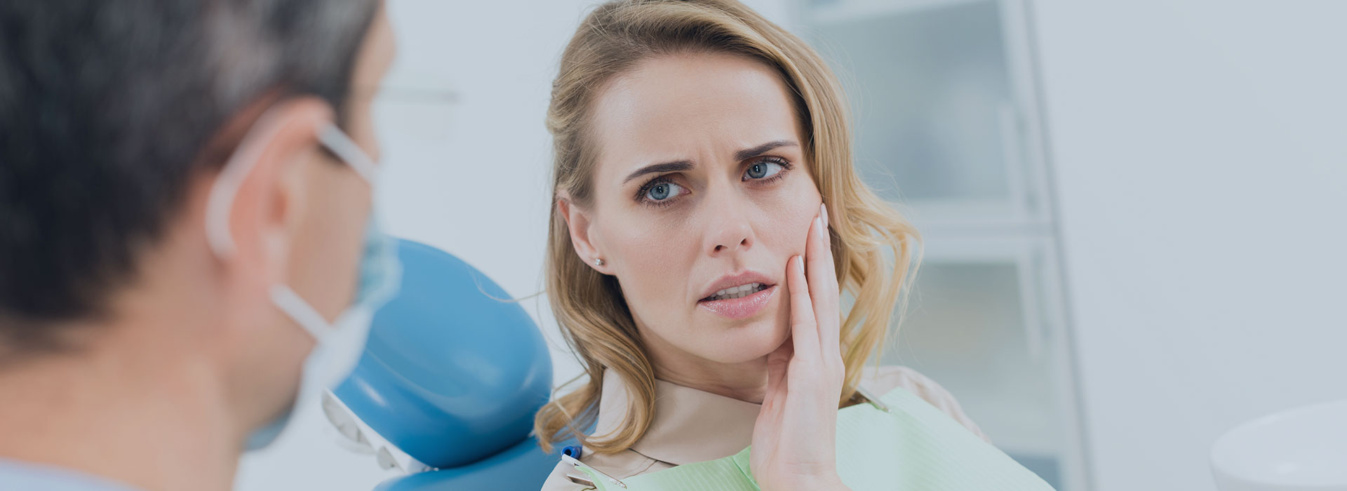 A woman is having a toothache