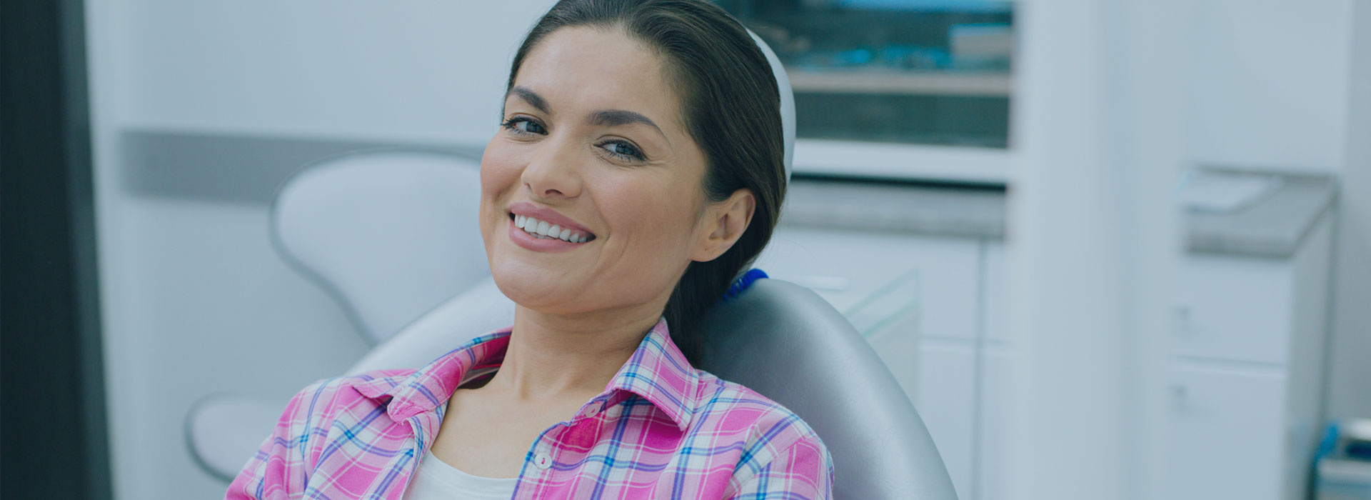 A woman is smiling after having invisalign