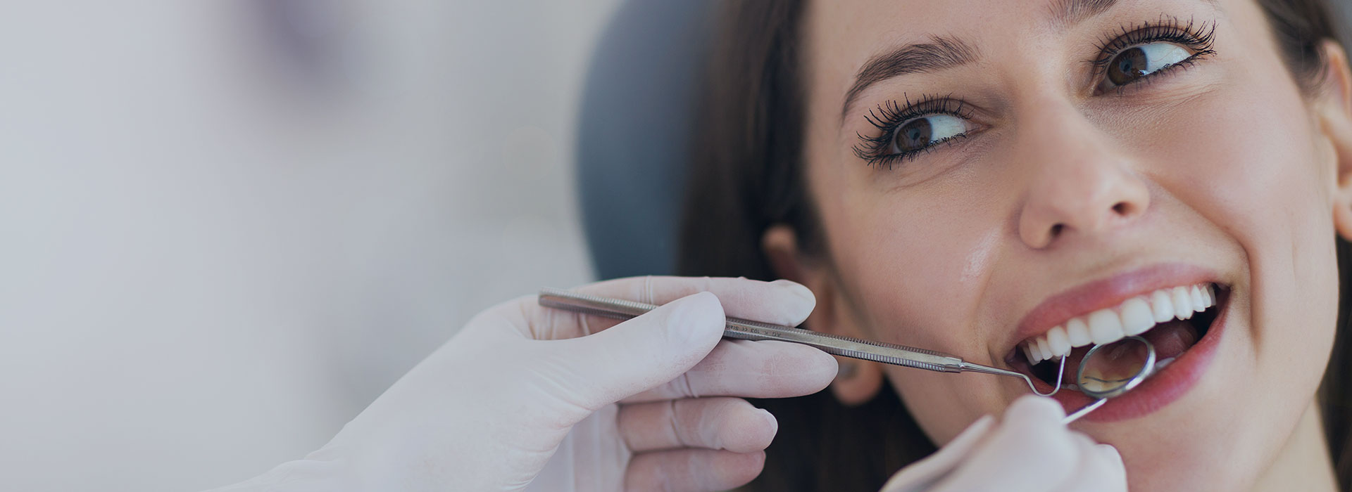 A woman is smiling after teeth whitening